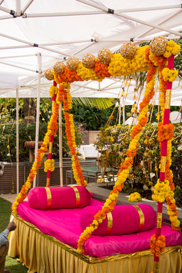 A swing seating for a bride in bright colours