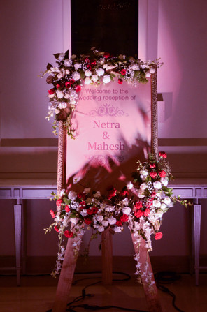 A name welcome board with flower decoration
