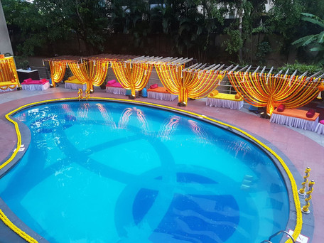 A poolside Mehendi function floral decoration in Bangalore