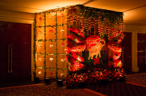 An elephant print backdrop and exquisite floral work as an installation for a wedding in Bangalore