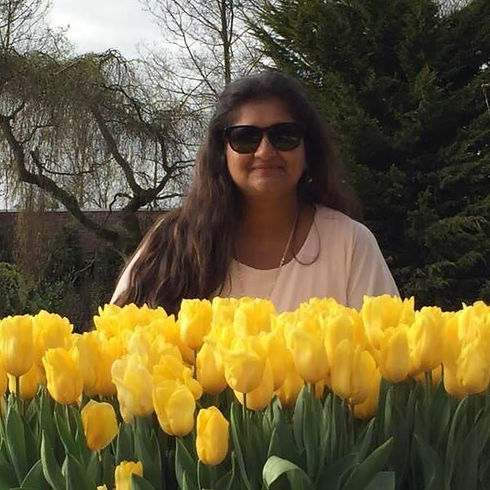 Lady with yellow tulip flowers in front of her