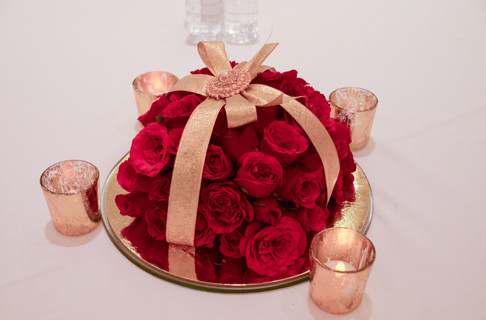 A rose gift box with candles as table center pieces
