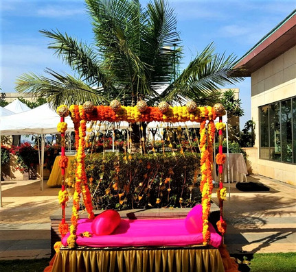 A bridal swing seating with coloruful Indian flowers