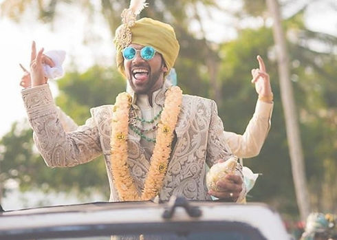 Indian groom dancing at his baarat