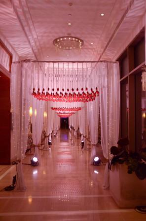 A tunnel of hanging roses for the entrance passage at an Indian wedding