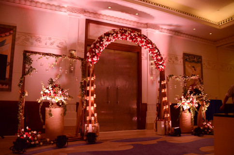 Over whelming flower decoration at the entrance of a wedding reception in Bengaluru