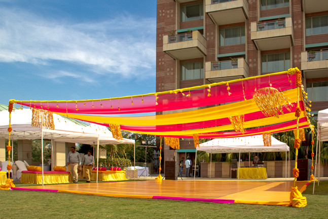 An outdoor wedding venue with colourful draping