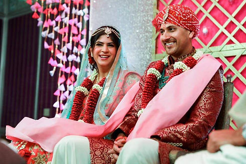 Newly married Indian couple smiling after their wedding
