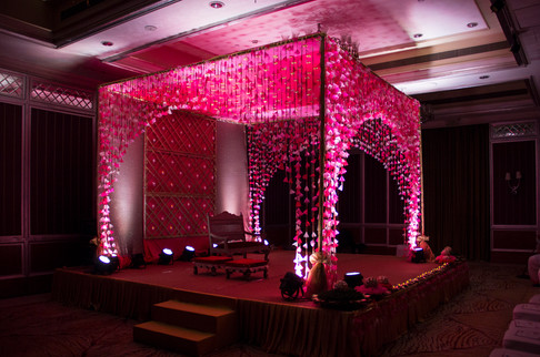 An Indian wedding celebration set up with flowers and fabric