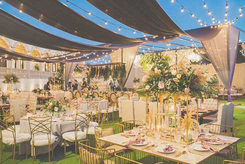 An outdoor Indian wedding venue, decorated with flowers and lights in Bangalore