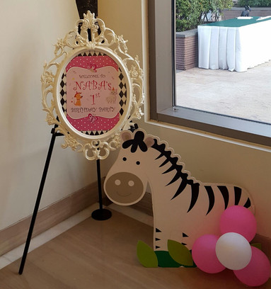 A creative name board for a young girls birthday celebration decor