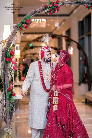 An Indian couple looking into each others eyes after their wedding in Bangalore