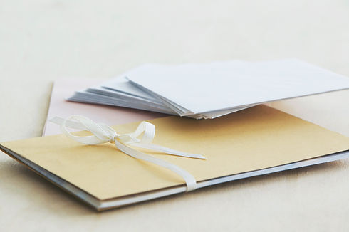 Envelopes with an ribbon covering depicting wedding invites