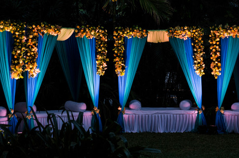 Floral bands with blue fabric and seating at a social funtion