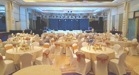 Corporate event set up with tables, chairs and a stage