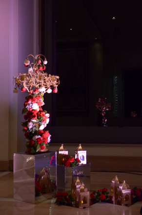 A unique floral installation with lanterns, mirror boxes, flowers and candle holders