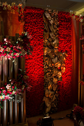 A red rose and gold leaf floral backdrop