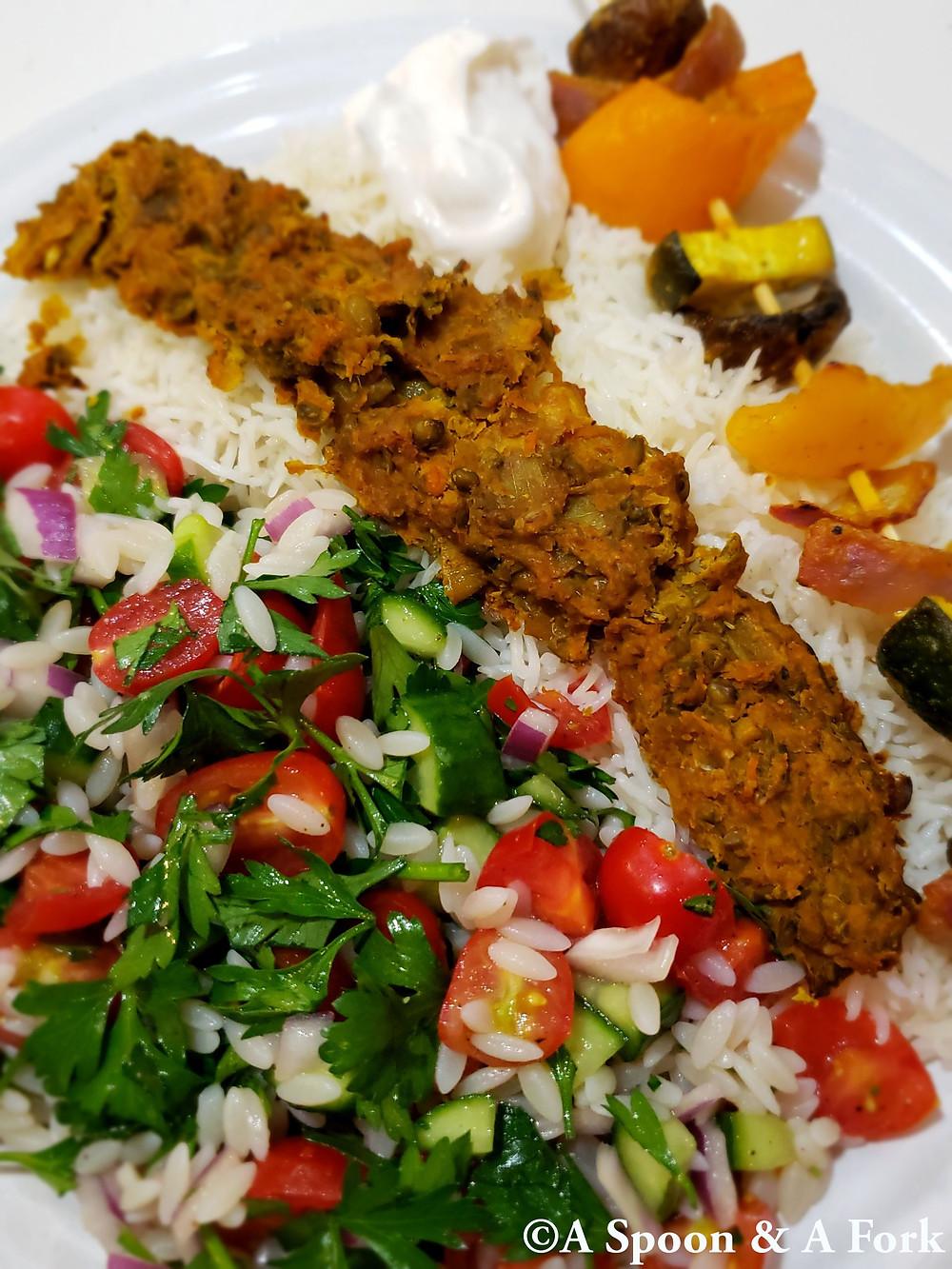Afghan Veggie Shawarma, Afghan Veggie Kabob, basmati and Israeli Salad with Orzo plate