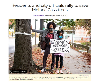 City Counselor Kim Janey stands with her daughter holding a #SaveMelneasTrees sign
