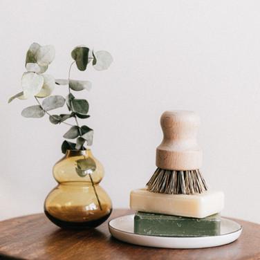 soaps-with-shaving-brush-near-vase-on-wo