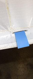 Using a small strip of plastic to enable the battens to slide gently in