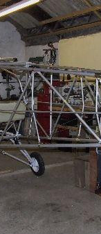 Attach the rear tubes and bracing to form the fuselage