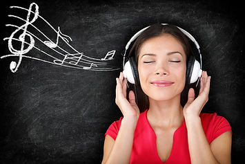 Listening-To-Music-Woman-with-headphones