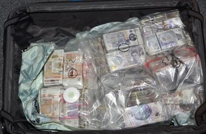 Woman 'tried to smuggle £2m in suitcases on plane from Heathrow to Dubai' - money laundering charge