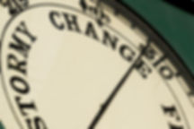 old barometer with needle pointing to change
