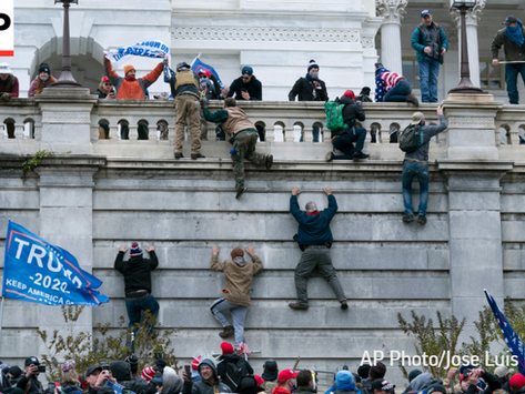 A mob of Trump supporters storms Capitol Hill in Washington D.C. in an attempt of a Coup D'etat