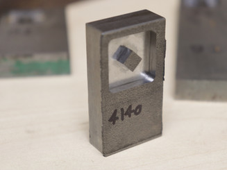 A square cut into some 4140 alloy steel