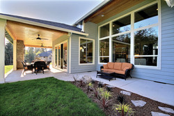 Style Line Picture Windows and Single Hung Windows White Exterior
