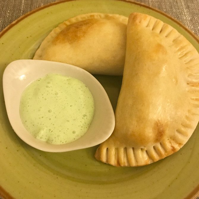 Chicken Empanadas with Cilantro Cream Sauce