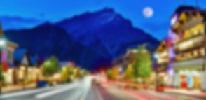 Street view of famous Banff Avenue at tw
