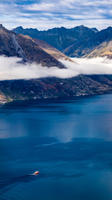 A tour boat leaves Queenstown Harbour, New Zealand