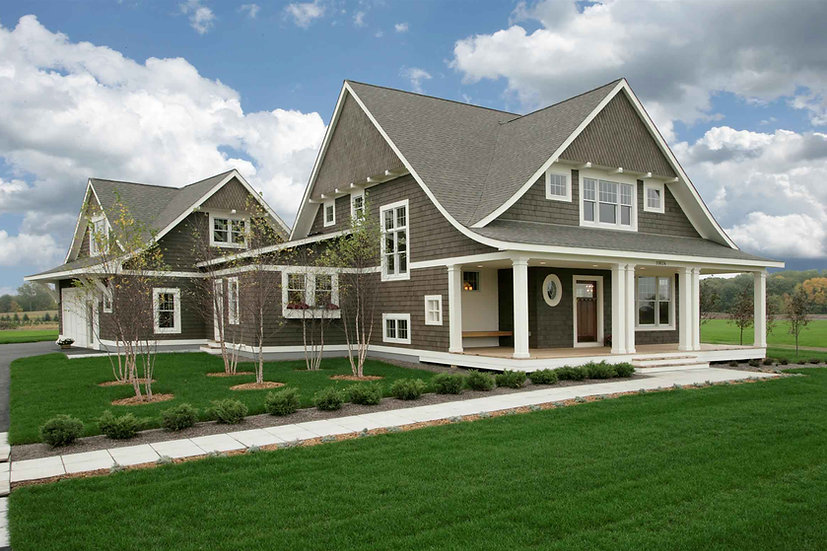 Modern Cape Cod with front porch, curved roof lines, dormers, attached garage and cedar shingle siding