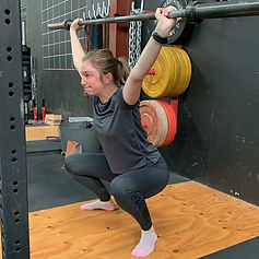 Female athlete overhead squat strength and conditioning.