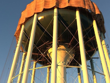 Legged elevated water tower