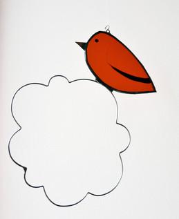 Mobile d'oiseau sur nuage