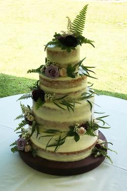 four tiered semi-naked wedding cake