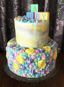 Pastel two tiered baby shower cake