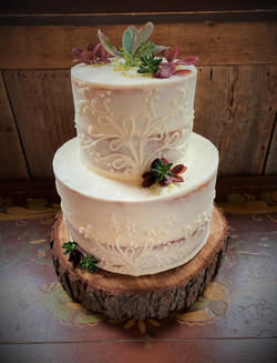 Nearly naked cutting cake with piping