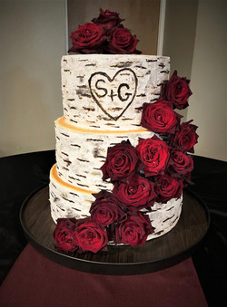 Massive birch cake with cascading roses
