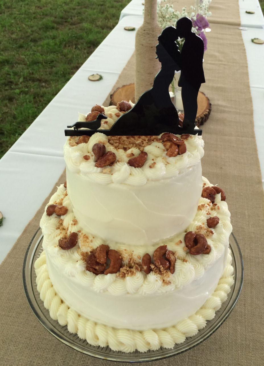 Cashew Ginger Carrot two-tiered cake with a delightful wedding topper!