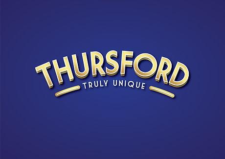 Thursford_logo_strap_GOLD_Blue.jpg