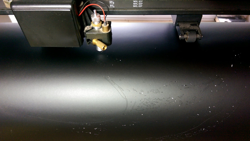 Plotter busy cutting out the vinyl layer