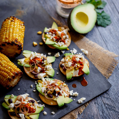GENUINELY SOUTHERN FORESTS AVOCADO TOSTADA WITH GRILLED CORN AND PICKLED SHALLOTS