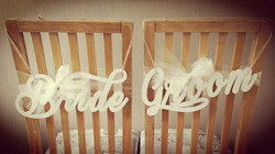 White wooden chair signs