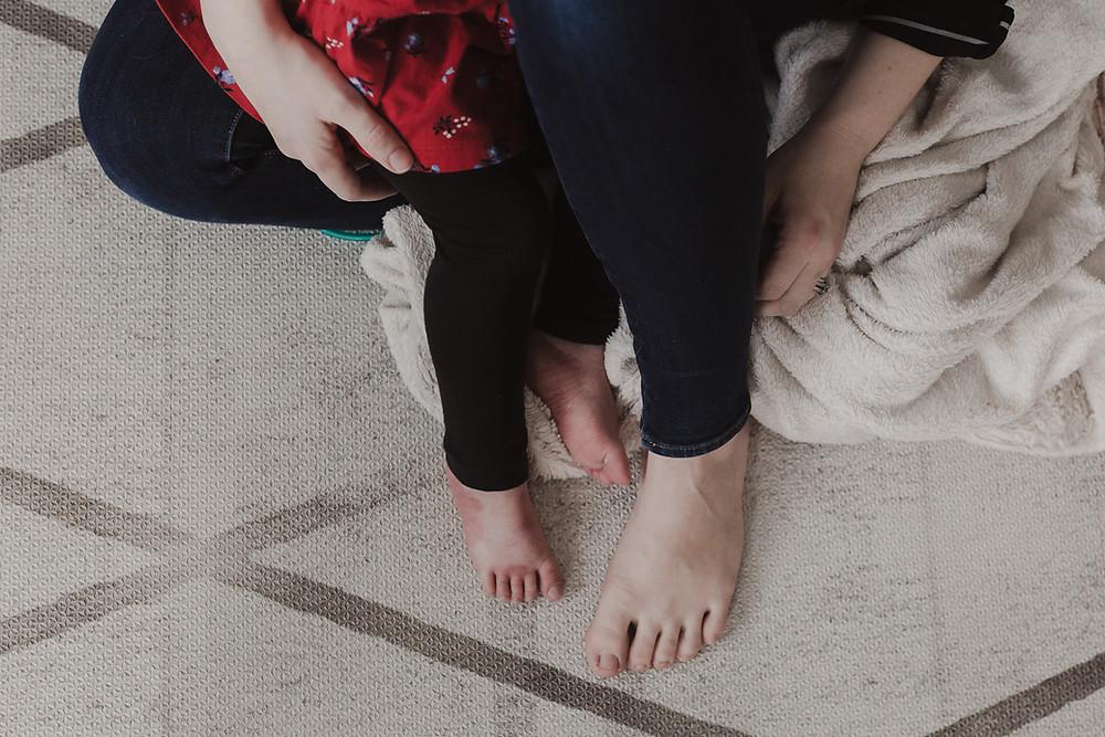 Daughter sitting on moms lap