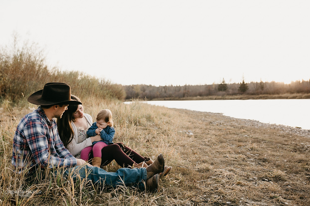 Family Sitting on the river bank for family photos with Jordana Baker Photography